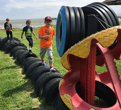 Children running through an obstacle course