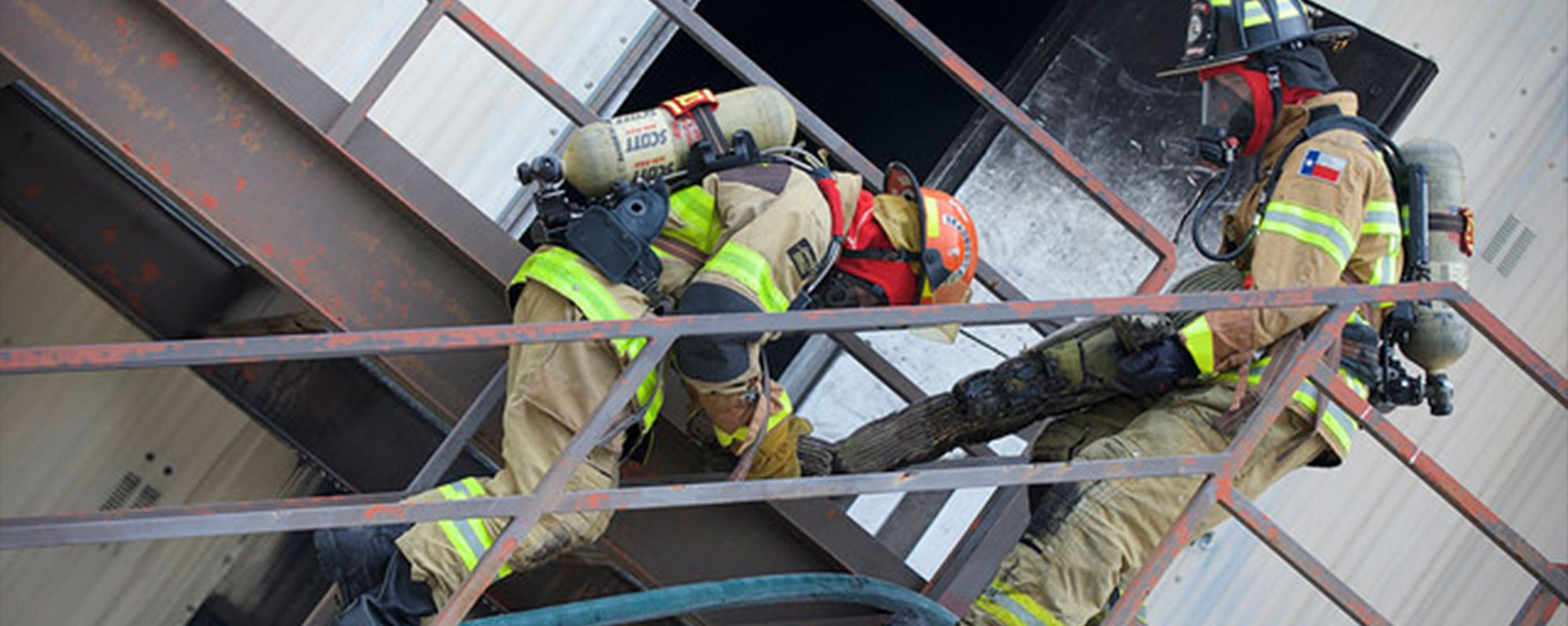Two firemen at work