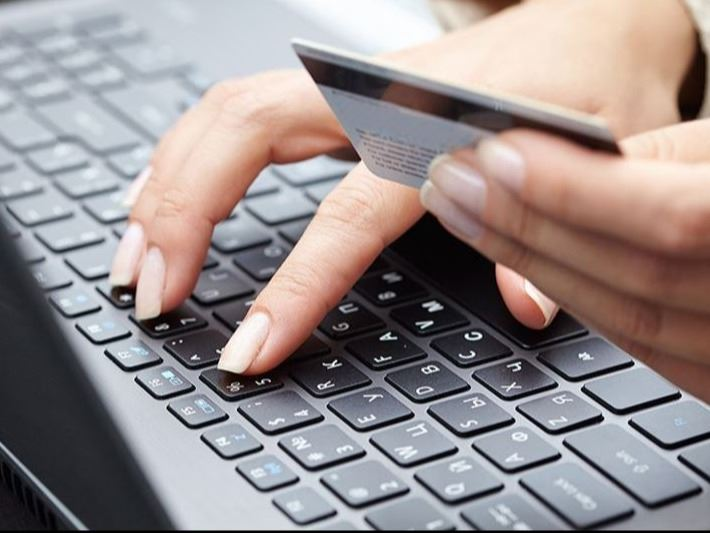 Woman paying bill online